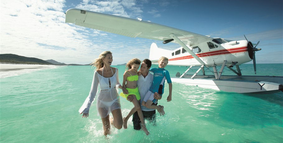 Family at Whitehaven Beach by Seaplane