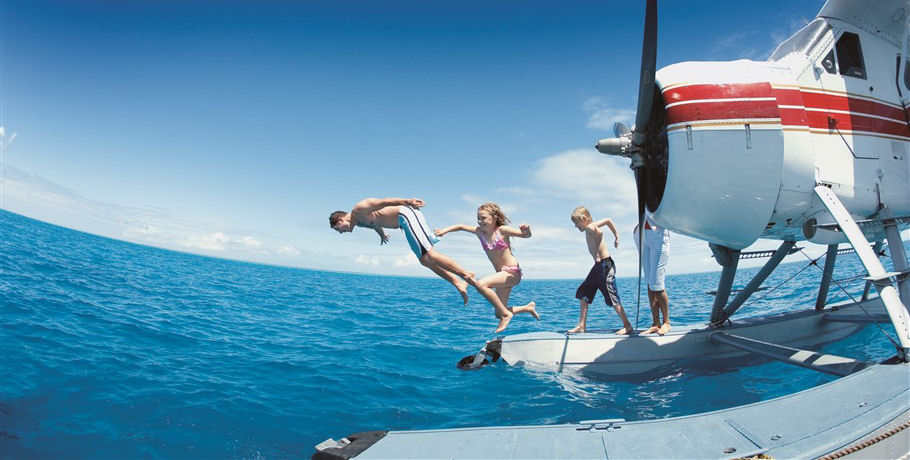 People jumping off a Seaplane into the ocean
