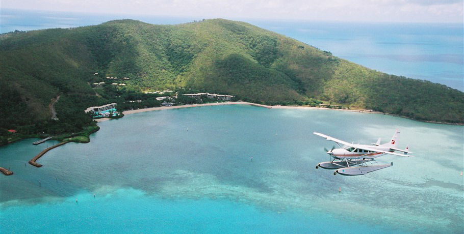Seaplane flying over Hayman Island